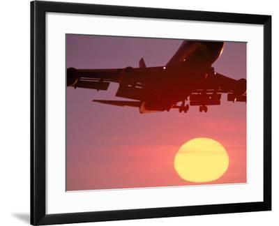Airplane in Flight During Sunrise, Sunset-Mitch Diamond-Framed Photographic Print