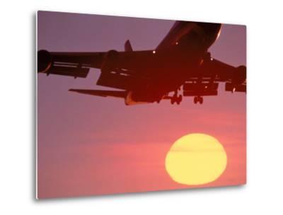 Airplane in Flight During Sunrise, Sunset-Mitch Diamond-Metal Print