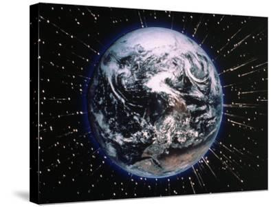 Earth Bombarded by Stars-Chris Rogers-Stretched Canvas Print