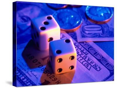 Dice and Money on Blue Background-Jim McGuire-Stretched Canvas Print