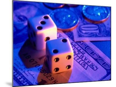 Dice and Money on Blue Background-Jim McGuire-Mounted Photographic Print