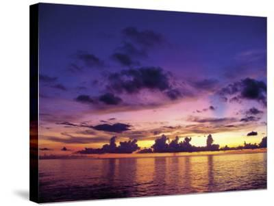 Sunset in the Cayman Islands-Anne Flinn Powell-Stretched Canvas Print