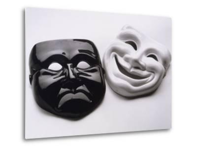 Black and White Image of Ceramic Theater Masks-Howard Sokol-Metal Print