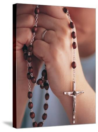 Woman Praying with Rosary Beads-Jim Corwin-Stretched Canvas Print