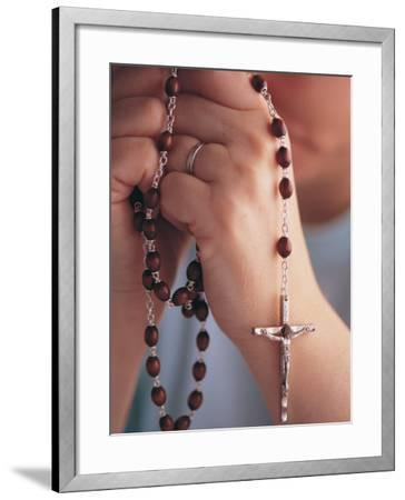Woman Praying with Rosary Beads-Jim Corwin-Framed Photographic Print