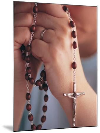 Woman Praying with Rosary Beads-Jim Corwin-Mounted Photographic Print
