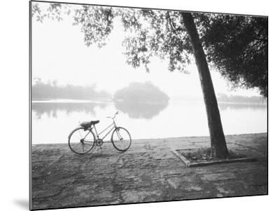 Bicycle and Bay Mau Lake Lenin Park-Walter Bibikow-Mounted Photographic Print