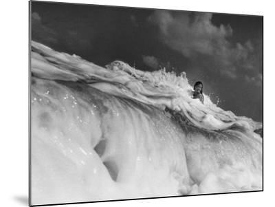 S. Florida, Woman Playing in Surf-Pat Canova-Mounted Photographic Print