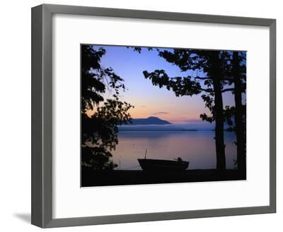 Silhouette of a Motor Boat on the Shores of a Bay in Alaska-Joel Sartore-Framed Photographic Print