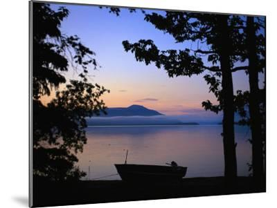 Silhouette of a Motor Boat on the Shores of a Bay in Alaska-Joel Sartore-Mounted Photographic Print
