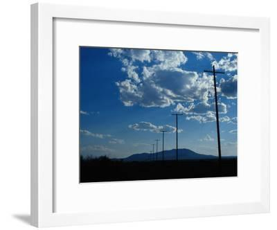 ce424674c6bf Silhouetted Telephone Poles under Puffy Clouds-Raymond Gehman-Framed  Photographic Print
