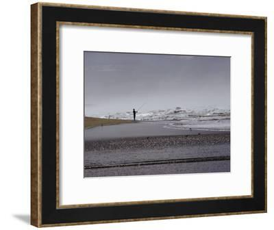 A Fisherman Casts His Line into the Surf-Marc Moritsch-Framed Photographic Print