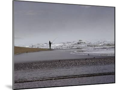 A Fisherman Casts His Line into the Surf-Marc Moritsch-Mounted Photographic Print