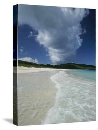 A Strip of Cumulous Clouds Follows This Receding, Tropical Shoreline-Michael Melford-Stretched Canvas Print