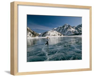 A Girl Ice Skates Across a Frozen Mountain Lake-Michael S^ Quinton-Framed Photographic Print