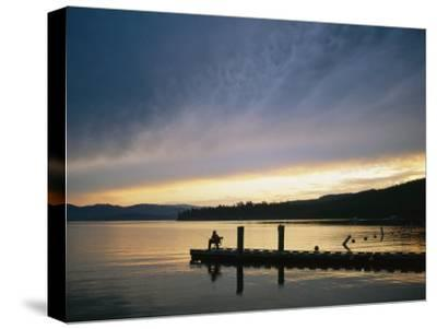 A Fisherman at Dawn Tries His Luck from the End of a Pier-Michael S^ Lewis-Stretched Canvas Print
