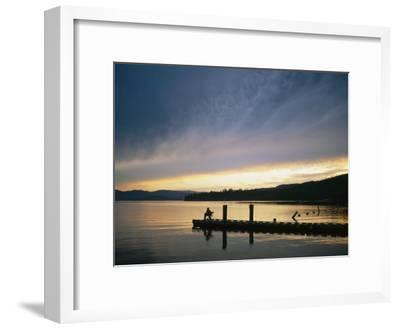 A Fisherman at Dawn Tries His Luck from the End of a Pier-Michael S^ Lewis-Framed Photographic Print