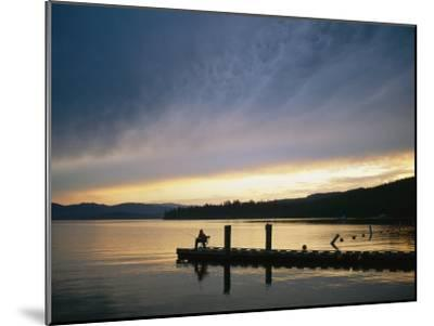A Fisherman at Dawn Tries His Luck from the End of a Pier-Michael S^ Lewis-Mounted Photographic Print
