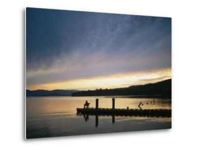 A Fisherman at Dawn Tries His Luck from the End of a Pier-Michael S^ Lewis-Metal Print