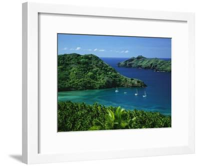 Sailboats Anchored in a Cove of Blue Water on an Asian Island-Tim Laman-Framed Photographic Print