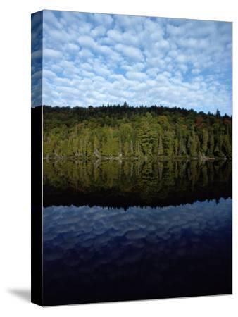 Shoreline and Clouds Reflected in the Still Waters of Rainbow Lake-Sam Abell-Stretched Canvas Print