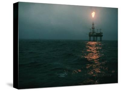 Night View of a Plume of Fire from an Offshore Oil Rig in This Norwegian Oil Field-Emory Kristof-Stretched Canvas Print