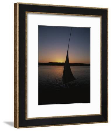 Sunset Outlines the Curve of a Felucca Sail on the Nile River-Stephen St^ John-Framed Photographic Print