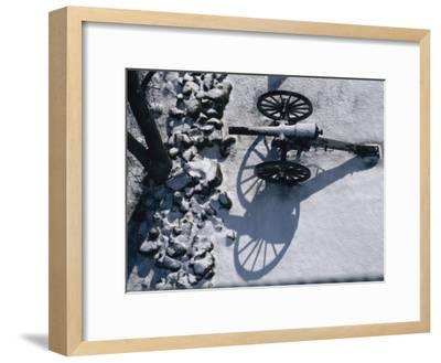 Fresh Snowfall Outlines a Cannon in This Winter View of Gettysburg-Stephen St^ John-Framed Photographic Print