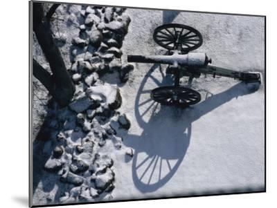 Fresh Snowfall Outlines a Cannon in This Winter View of Gettysburg-Stephen St^ John-Mounted Photographic Print