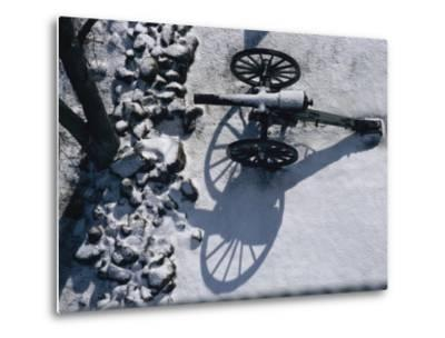 Fresh Snowfall Outlines a Cannon in This Winter View of Gettysburg-Stephen St^ John-Metal Print