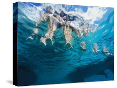 Boaters Dangle Their Feet in the Caribbean Sea-Heather Perry-Stretched Canvas Print