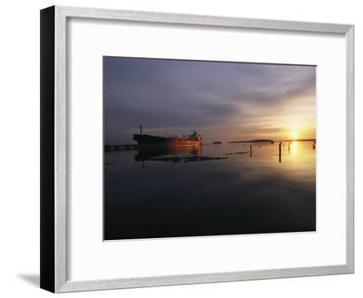 Twilight View of a Ship at Anchor in Still Water at Low Tide-Bill Curtsinger-Framed Photographic Print