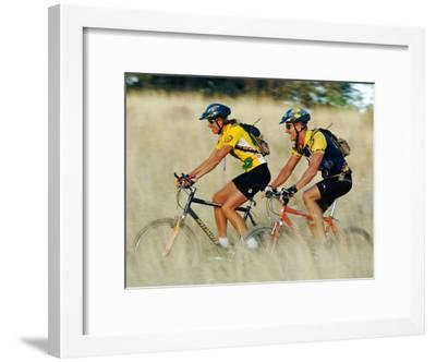 A Couple of Mountain Bikers Ride Along the Dirt Path-Barry Tessman-Framed Photographic Print
