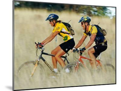 A Couple of Mountain Bikers Ride Along the Dirt Path-Barry Tessman-Mounted Photographic Print
