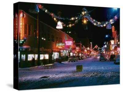 Second Avenue, the Main Business Street in Fairbanks, Decorated for Christmas-W^ Robert Moore-Stretched Canvas Print