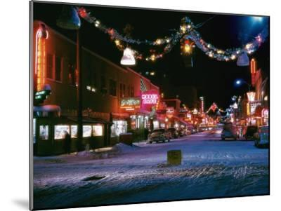 Second Avenue, the Main Business Street in Fairbanks, Decorated for Christmas-W^ Robert Moore-Mounted Photographic Print