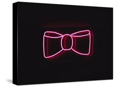 A Bright Pink Neon Bowtie Outside a Restaurant-Stephen St^ John-Stretched Canvas Print