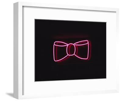 A Bright Pink Neon Bowtie Outside a Restaurant-Stephen St^ John-Framed Photographic Print