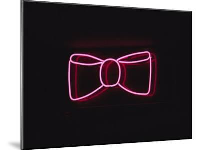 A Bright Pink Neon Bowtie Outside a Restaurant-Stephen St^ John-Mounted Photographic Print