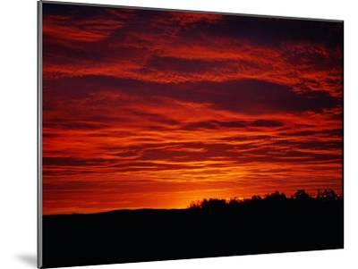 A Sunrise Bathes the Clouds in a Red Glow-Heather Perry-Mounted Photographic Print