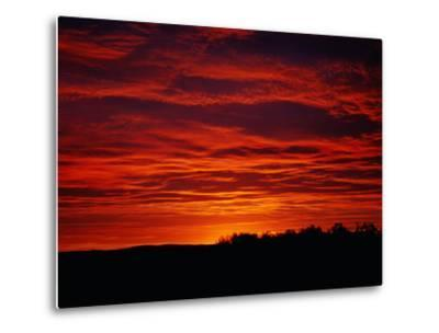 A Sunrise Bathes the Clouds in a Red Glow-Heather Perry-Metal Print