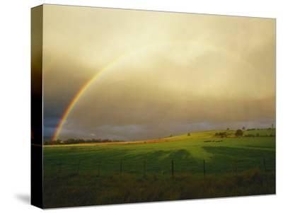 A Rainbow Appears over the Landscape-Jason Edwards-Stretched Canvas Print