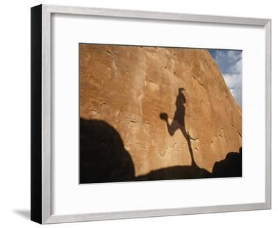 A Runners Shadow Falls on a Rock-Dugald Bremner-Framed Photographic Print