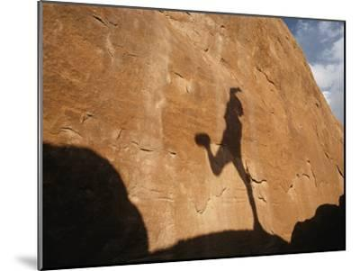 A Runners Shadow Falls on a Rock-Dugald Bremner-Mounted Photographic Print
