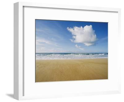 A Large Cloud Dominates the Sky as the Surf Rolls onto a Sandy Beach-Skip Brown-Framed Photographic Print