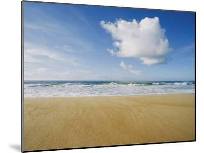 A Large Cloud Dominates the Sky as the Surf Rolls onto a Sandy Beach-Skip Brown-Mounted Photographic Print