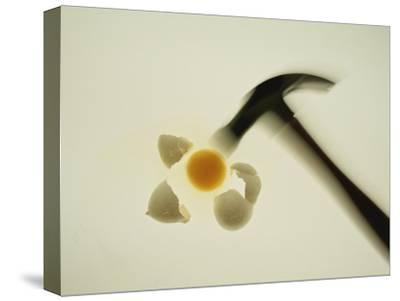 A Blurred Hammer Cracks Open an Egg-Stephen St^ John-Stretched Canvas Print