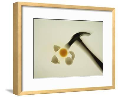 A Blurred Hammer Cracks Open an Egg-Stephen St^ John-Framed Photographic Print