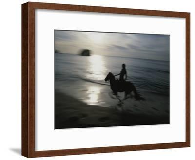 Horseback Rider Silhouetted on Beach, Costa Rica-Michael Melford-Framed Photographic Print