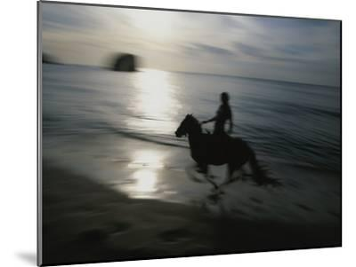 Horseback Rider Silhouetted on Beach, Costa Rica-Michael Melford-Mounted Photographic Print